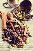 pic of cardamom  - Coffee beans star anise cardamom and cinnamon on burlap  - JPG