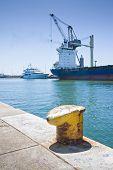 pic of dock  - Merchant ship docked in an Italian port  - JPG
