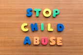 pic of child abuse  - stop child abuse colorful words on the wooden background - JPG