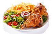 pic of thighs  - Grilled turkey thighs with chips and vegetables  - JPG
