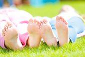 pic of naked children  - Children  heels on the grass - JPG