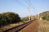 pic of vegetation  - railway line running between vegetation alongside indian ocean coastline in South Africa - JPG