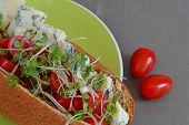 foto of plum tomato  - Wholemeal Sub Roll with Blue Cheese and Ripe Cherry Tomatoes - JPG
