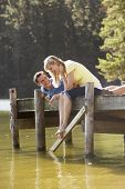 pic of jetties  - Romantic Couple Sitting On Wooden Jetty Looking Out Over Lake - JPG