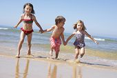 pic of children beach  - Children Running Along Beach - JPG