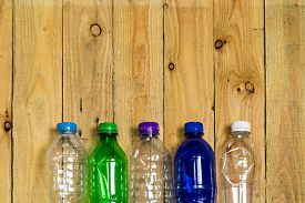 stock photo of plastic bottle  - used plastic bottles  for recycle on wooden board - JPG
