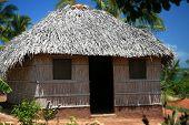 Straw Hut Near The Ocean
