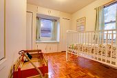stock photo of crip  - Baby room with crop and window seat - JPG