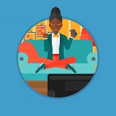 An african happy gamer playing video game on the television. An excited woman with console in hands  poster