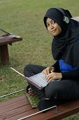Malay female teen with laptop