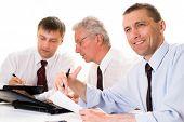 Three Businessmen Working