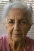 stock photo of old lady  - A very old lady smiling into the camera - JPG