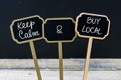 Keep Calm And Buy Local Message Written With Chalk On Mini Blackboard Labels poster