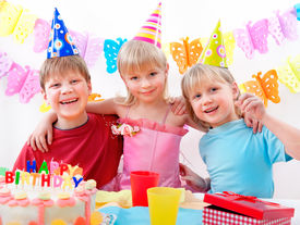 foto of happy birthday  - Three kids are happily posing during birthday party - JPG