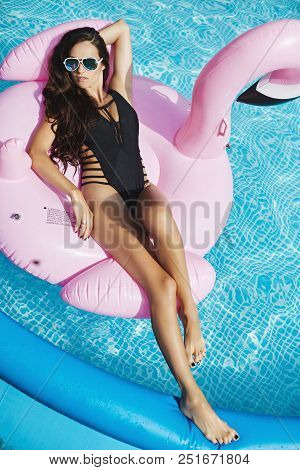poster of Fashionable And Ssensual Brunette Model Girl With Perfect Sexy Body In Stylish Black Bikini And Glam