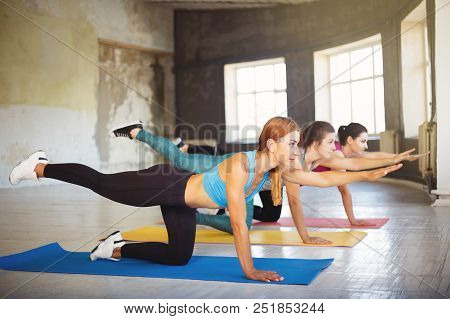poster of Yoga Class, Pilates, Fitness, Flexibility, Activity And Healthy Lifestyle. Fit Sporty Women Working