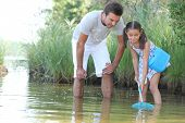 stock photo of long-fish  - Father and daughter with a fishing net - JPG