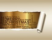 stock photo of merry christmas text  - ripped paper displaying a golden background with christmas greetings in different languages - JPG