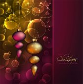 romantic christmas background with ornaments against blurred warm lights