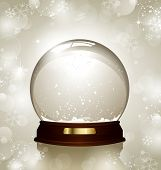 empty snowglobe against a bright defocused background with glittering lights and snowflakes - customize by inserting your own object!