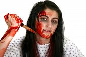 foto of serial killer  - Young Middle Eastern woman covered in blood with knife - JPG