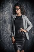 Portrait of a beautiful businesswoman wearing formal clothes and glasses. poster