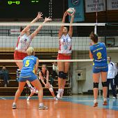 KAPOSVAR, HUNGARY - OCTOBER 21: Zsanett Pinter (blue 2) in action at a Hungarian NB I. League volley