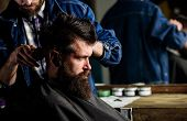 Hipster Client Getting Haircut. Barber Styling Hair Of Bearded Client With Comb And Clipper. Barber  poster