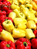 Red and yellow peppers on market