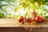 Honey And Apples On Wooden Table. Jewish Holiday Rosh Hashanah Background poster