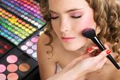 stock photo of makeup artist  - Makeup artist applying blusher - JPG