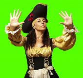 portrait of pirate woman gesturing stop against a removable chroma key background