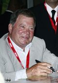 SAN DIEGO - JULY 23: William Shatner signs autographs during Day 2 of Comic-Con 2010 in San Diego, C