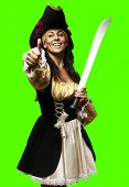portrait of pirate woman holding sword against a removable chroma key background