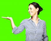 portrait of a middle aged woman holding gesture against a removable chroma key background