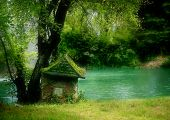 stock photo of fairy-tale  - small green house near the beautiful lake - JPG