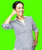 portrait of a middle aged woman talking gesture against a removable chroma key background