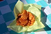 crinkle cut French fries. Freedom Fries cut in a crinkle pattern and deep fried in hot oil. poster