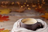 Autumn Background From Cup Of Cocoa Or Coffee In Knitted Warm Scarf On Wooden Table Decorated With F poster