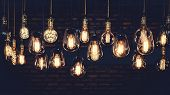 Beautiful Vintage Luxury Light Bulb Hanging Decor Glowing In Dark. Retro Filter Effect Style. poster