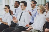 Team Of Multiracial Businesspeople Clapping Hands During Business Conference. Successful People Conc poster