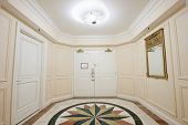 picture of anteroom  - Anteroom with white double door and mosaic marble floor - JPG