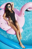 Fashionable And Ssensual Brunette Model Girl With Perfect Sexy Body In Stylish Black Bikini And Glam poster