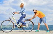 Teach Adult To Ride Bike. Man Helps Keep Balance And Ride Bike. Find Balance. Woman Rides Bicycle Sk poster
