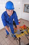 Plumber measuring plastic piping