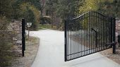 Automatic Steel Gate Opening On A Long Driveway poster