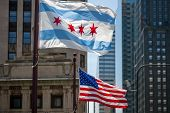 Waving Flags Of The City Of Chicago And Of The United States Of America In Downtown Chicago poster