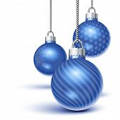 stock photo of christmas ornament  - Blue christmas ornaments hanging over white - JPG