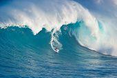 MAUI, HI - MARCH 13: Professional surfer Francisco Porcella rides a giant wave at the legendary big
