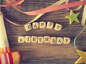 Happy Birthday, Wooden Dices On A Woodent Able With Birthday Decoration, Vintage Color Stylized poster